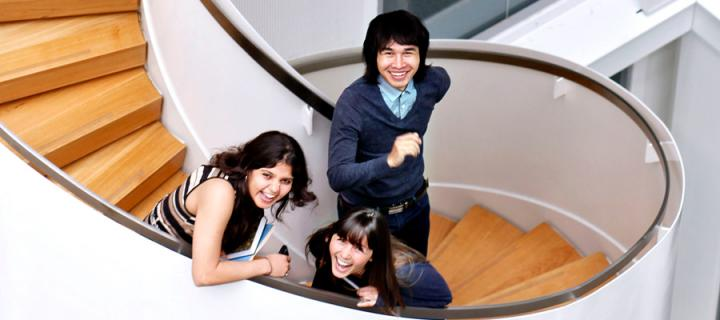Students on spiral staircase photograph